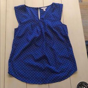 Blue and white polka dot top.